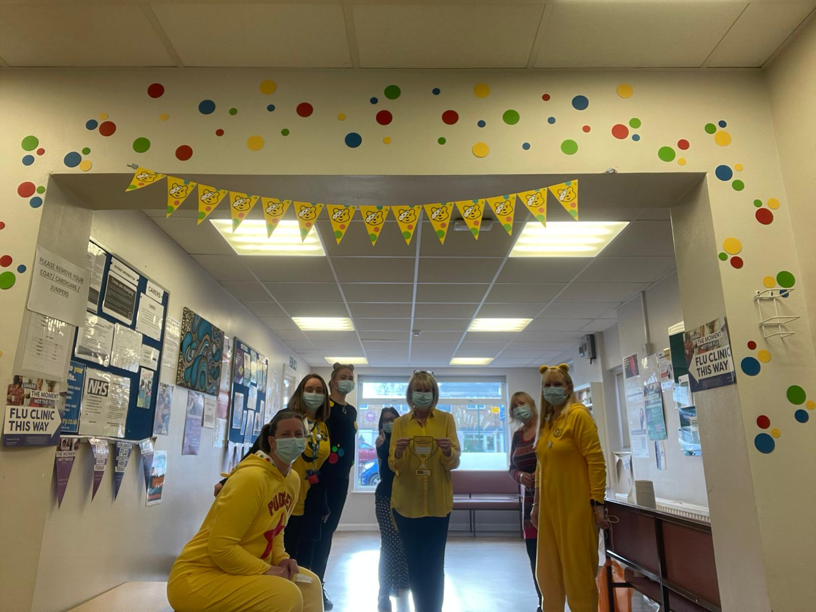 Staff members dressed for children in need